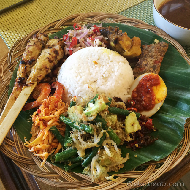 Nasi Campur Bali (Balinese Combination Rice) - IDR 45K  Steamed rice, fried peanuts, satay, satay lilit, lawar (soup), tum ayam, Balinese shrimps, sambal matah (Balinese raw chili), sambal mbe (Balinese chili), ayam sisit, ayam bumbu rajang, chili egg, sambal terasi (Javanese chili), urab. A must-try. Just like the food in Bali.