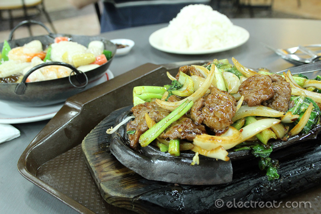 Sizzling Szechuan Beef - $10 including Rice  One of the best items here. From the entrance, walk to the corner diagonally across from you.