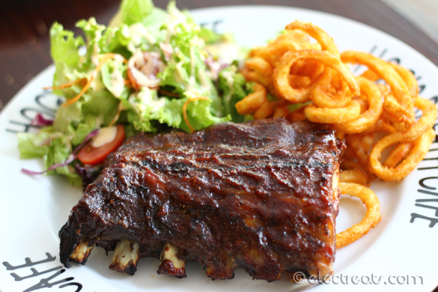 Smoked Pork BBQ Ribs (Half-Rack) - IDR 178K Hog's Style braised pork spare ribs basted in in-house Hickory Smoked BBQ Sauce and served with curly fries (or mash) and salad (or seasonal vegetables). A must-try.