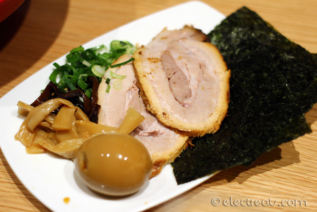 The Special - +$8 after Akamaru Shinaji  Akamaru with flavored egg, simmered pork belly, roasted seaweed, flavored black mushroom, bambo shoots, and spring onions. Here they come separately with the ramen.