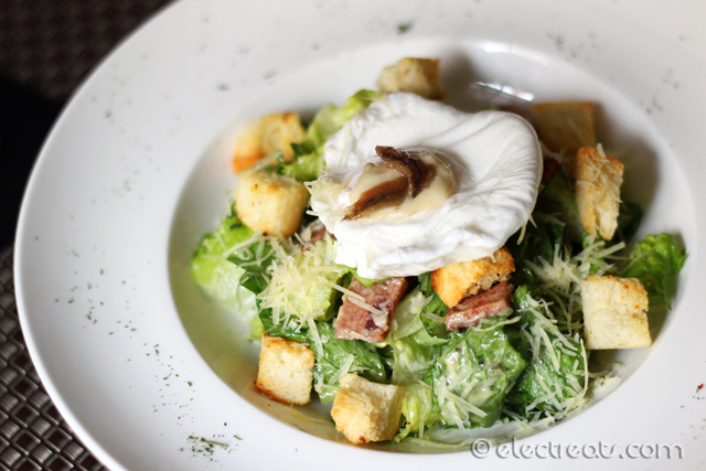 "Romaine Lettuce, Italian Anchovies, Poached Egg & Baked Croutons in Caesar Dressing - IDR 48  Or simply ""Le SIgnature Caesar Salad""."