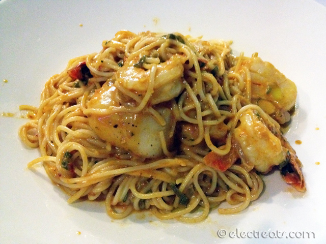 Macaronia tis Mykonou - $32  Prawns, scallops tossed with spaghetti in a light creamy tomato sauce and a dash of chilli.