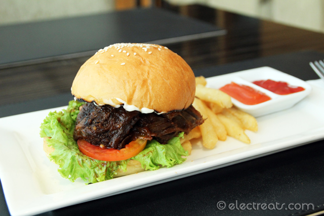 Grilled Barbecued Ribs with A Burger Bun - IDR 80K  It was like eating rendang (Indonesian spicy beef stew) with a burger bun!