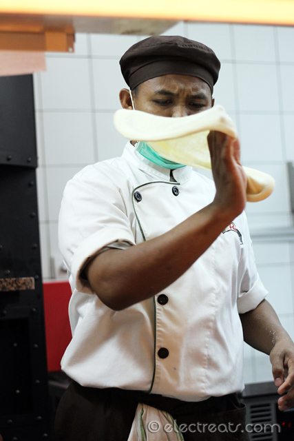 Here they claim all pizzas are made in-house. His facial expression says it all: a great focus is crucial in making a great pizza dough.
