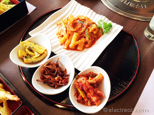 Topokki with Kimchi, Stir-fried Anchovies, and Candied Potatoes  A must-try.