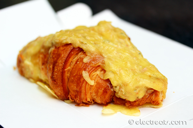 Ham and Cheese Croissant - $6.50 Take-away, $8 Dine-in Croissant filled with house mixture of creamy bechamel sauce, leg ham and topped with cheese. A must-try.