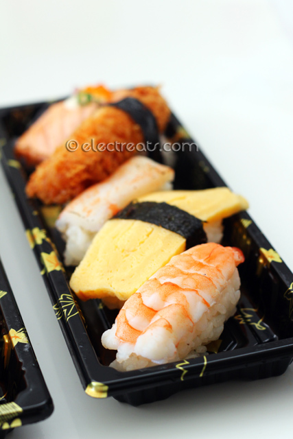 Nigiri Deluxe Box - $7 Front-Back: Ebi (Prawn), Tamago (Egg), Kani (Surimi or Crabstick), Ebi Furai (Fried-battered Prawn), Sake-Aburi (Torched Salmon).
